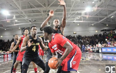 Rival Titans give Golden Grizzlies their first loss in conference