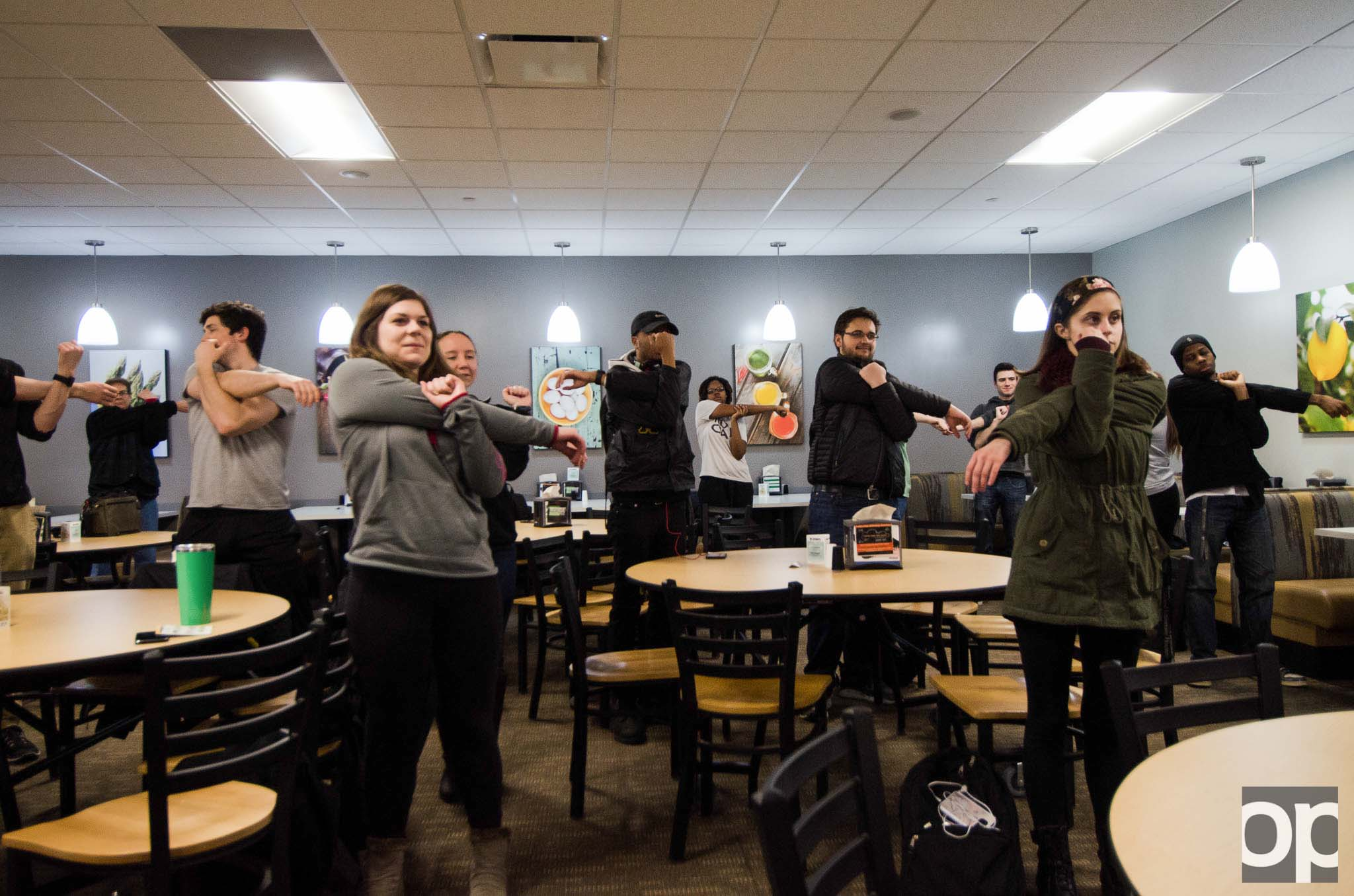 Participants practice different stretches and learn how to do quick activity movements while cramming for finals week at