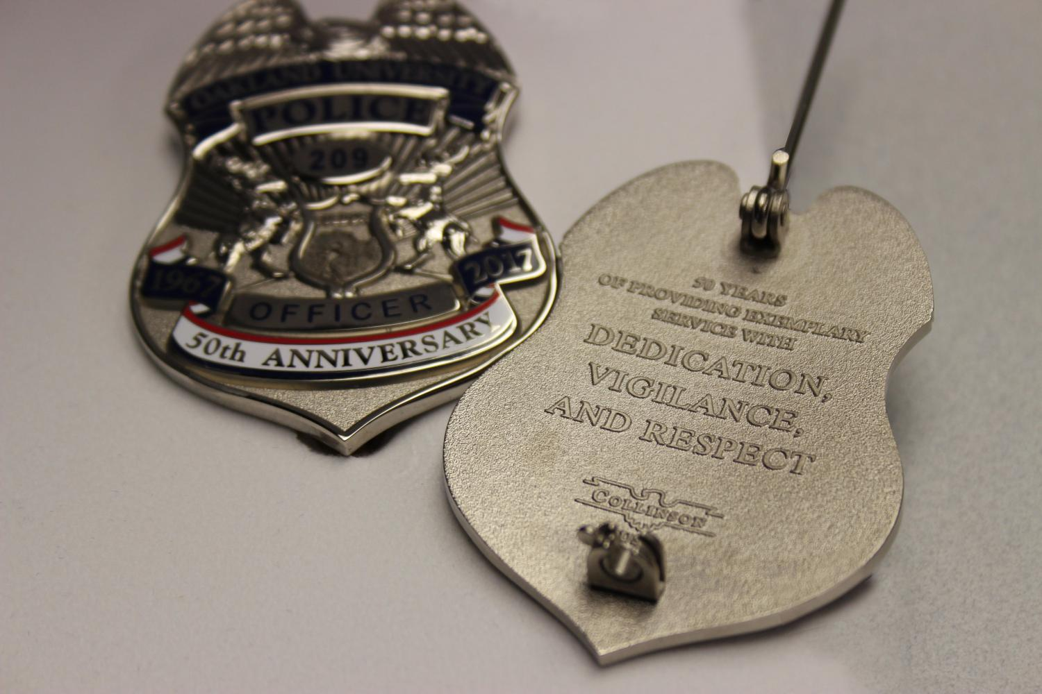 OUPD%27s+50th+Anniversary+badges.
