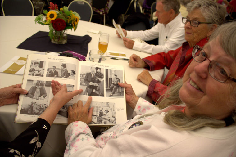 Patti Koenig, Charter Class Graduate of 1963, points to a photo of herself in the yearbook.