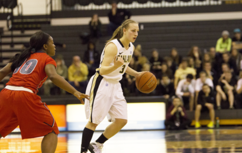 Sophomore guard Elena Popkey directs traffic for OU's offense. Popkey led the Grizzlies in scoring with 18 points.