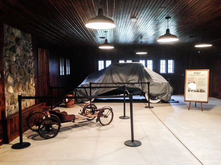 The cabin's garage, complete with an antique Dodge automobile. Daniel Dodge's father was a co-creator of Dodge automobiles.