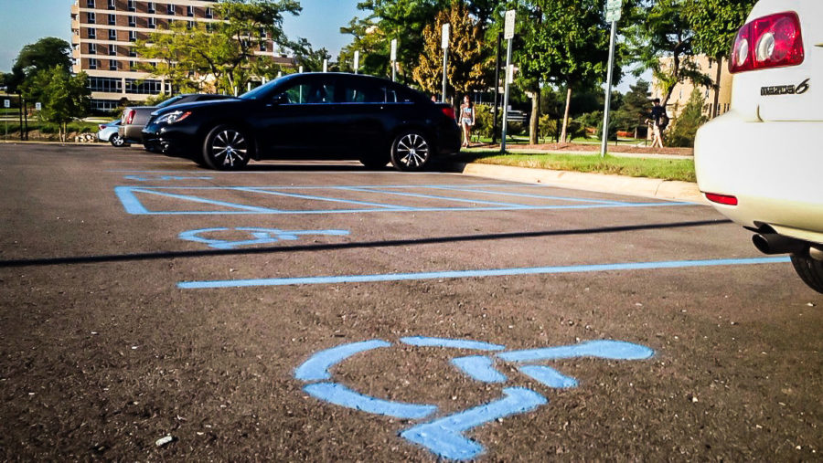 Many OU students have been parking in handicapped lots, not leaving enough space for students with wheelchairs to maneuver, according to junior Ize Speilman.