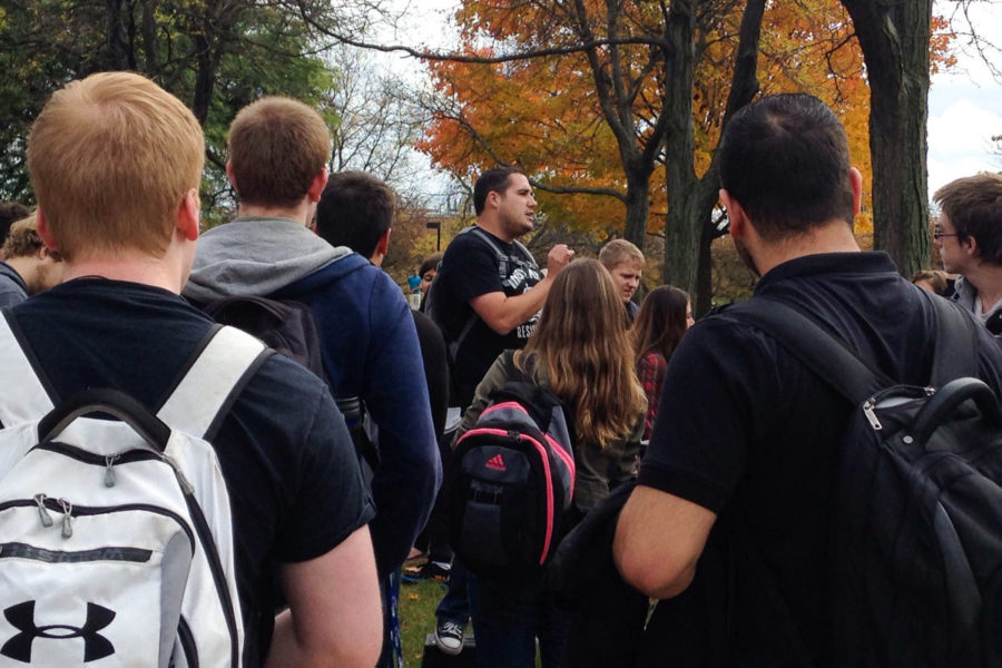 A man interrupted student displays last Wednesday, and a crowd gathered around him as he preached on pornography, homosexuality and other