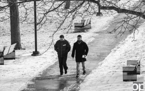 Students walk to class during below freezing temperatures.