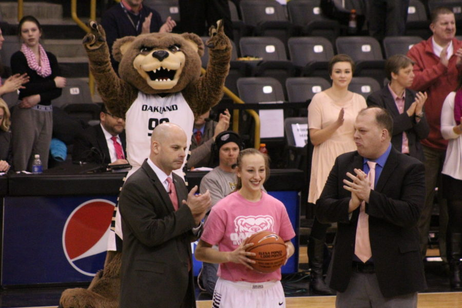 Elena Popkey being honored for recording 1,000 career points prior to Wednesday's pink game against Detroit.