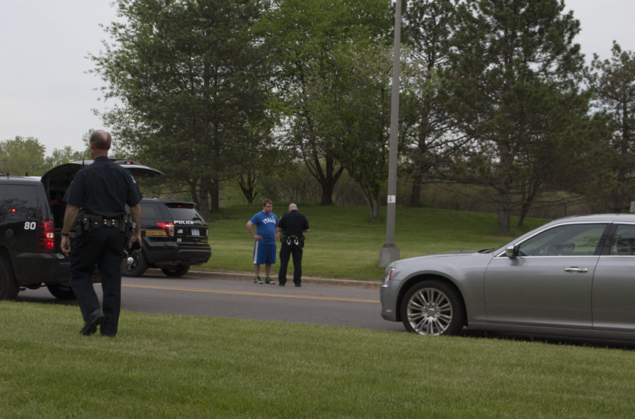 Police questioning the driver of the vehicle