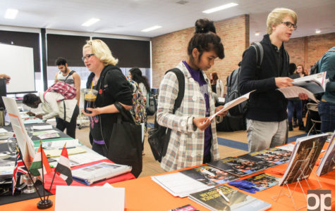 Students look at information on different countries that are part of the study abroad program.