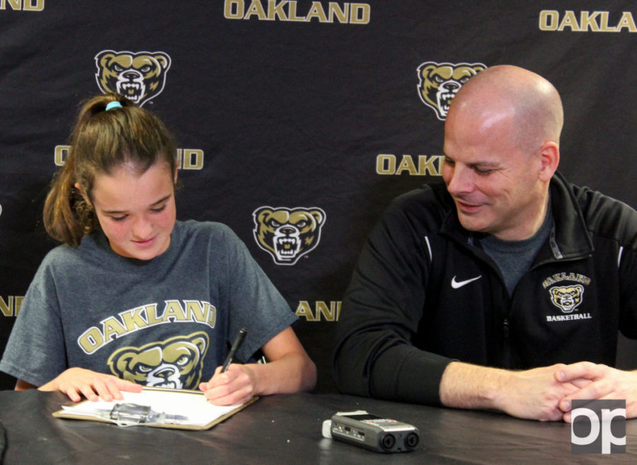 11-year-old Sofia Floros signs on to Oakland University's women's basketball team on Nov. 24.