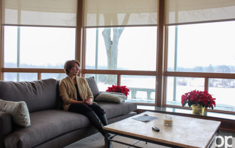 Dr. Allison Hynd sits in the living room of the Sunset Terrace. President George Hynd and his wife moved in to their new home on campus in early November.