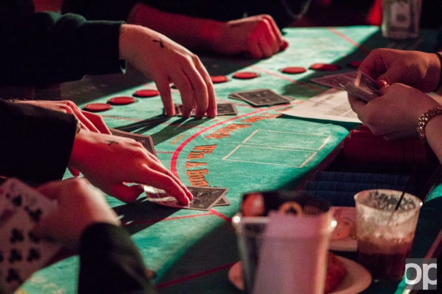 The dealer deals out a hand at Oakland University's Casino Night 2015.