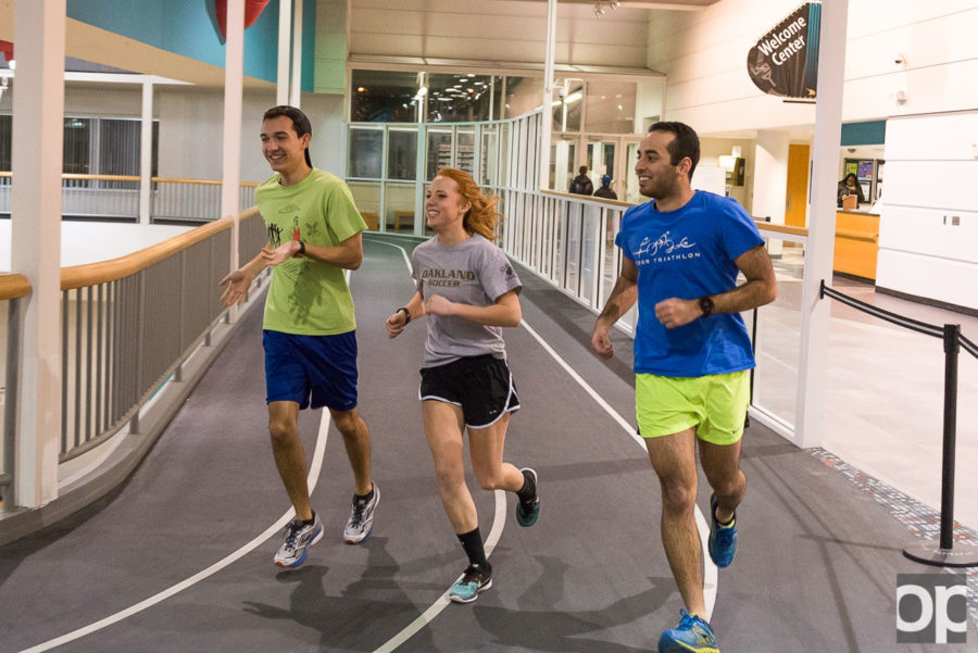 The Oakland Running club stays fit during the winter indoors at the Recreation Center.