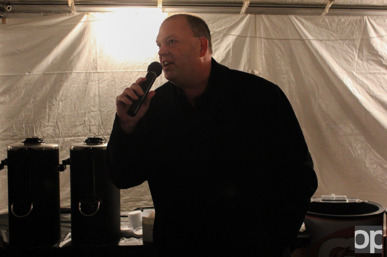 Athletic Director, Jeff Konya speaks to students inside the tent which held Winter Fest Activities and performances on Friday, Jan. 29.