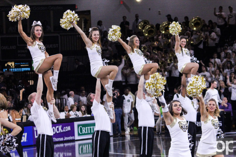 Five new male members were added to the cheer team to help support the university's athletics and entertain the crowds at home games.