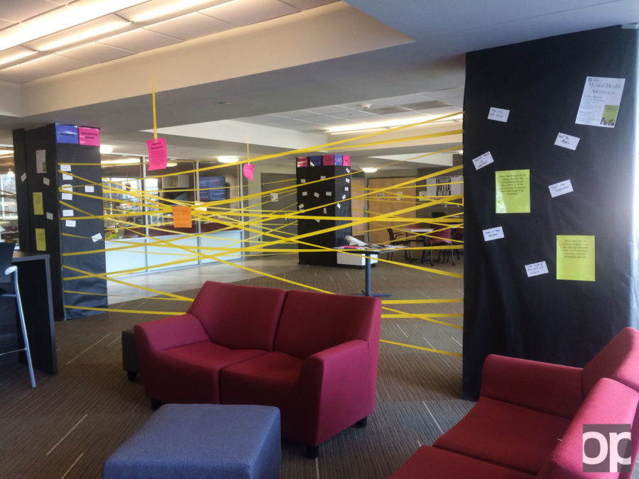 """The Residence Hall Association (RHA) worked with the Graham Health Center to put together a """"Room of Recognition"""" in Oak View Hall.The display was also purposely crafted in order to prevent the entire thing from collapsing if one string of the walls were pulled down."""