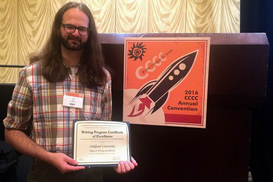 Jim Nugent, program director of the Writing and Rhetoric major, is pictured with the Writing Program Certificate of Excellence OU received from the Conference on College Composition and Communication.