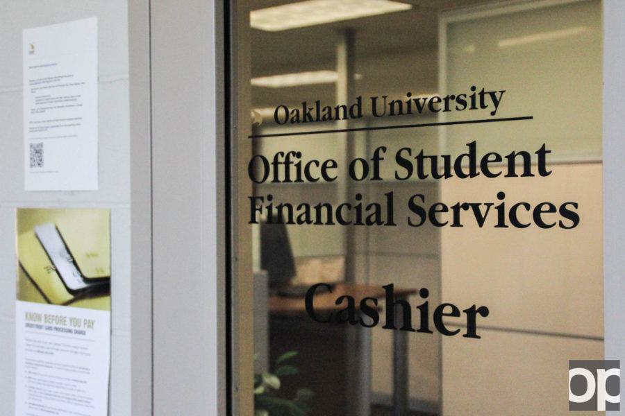 Student-employees who get paid through Oakland University for on-campus jobs receive their paychecks form the cashier's office in North Foundation Hall. The student-employee minimum wage will rise from $8.50 to $9.25, effective August 29.