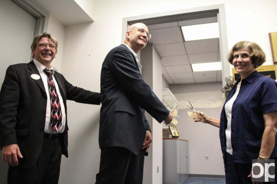 Dean Stephen Weiter, donor Lee Krompart and Linda Hildbrand cut the ribbon to the Krompart-Hildebrand Digitization Lab.