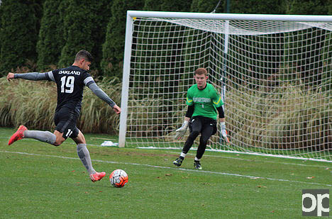 Austin Ricci takes a shot at the goal. Oakland lost to MSU 2-0 on Wednesday, Oct. 28.