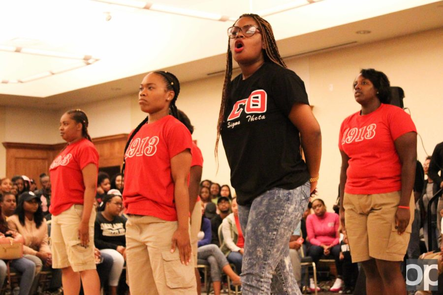 Delta Sigma Theta sorority girls chant and perform for the crowd.