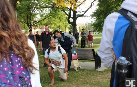 Ken Fleck, the person who grabbed a lot of students' attention on campus Wednesday, Sept. 21 as he preached, gets mocked by a student.