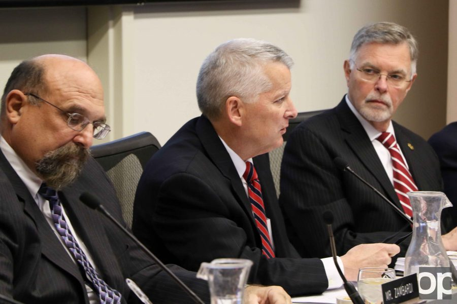 Board of Trustees Chairman Richard DeVore (center) will lead the search committee for President George Hynd's (right) successor.