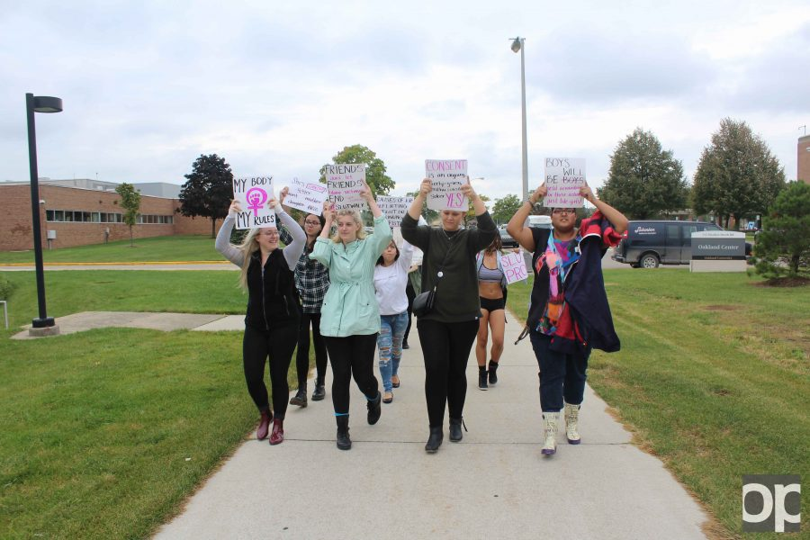 Members of the student org Feminists of OU held the slut walk event on campus and carried around signs protesting to end rape culture.