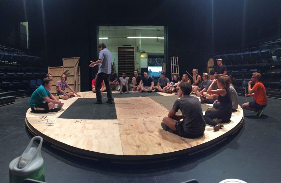Cast members listen to director of The Scarlet Pimpernel Fred Love giving blocking notes.