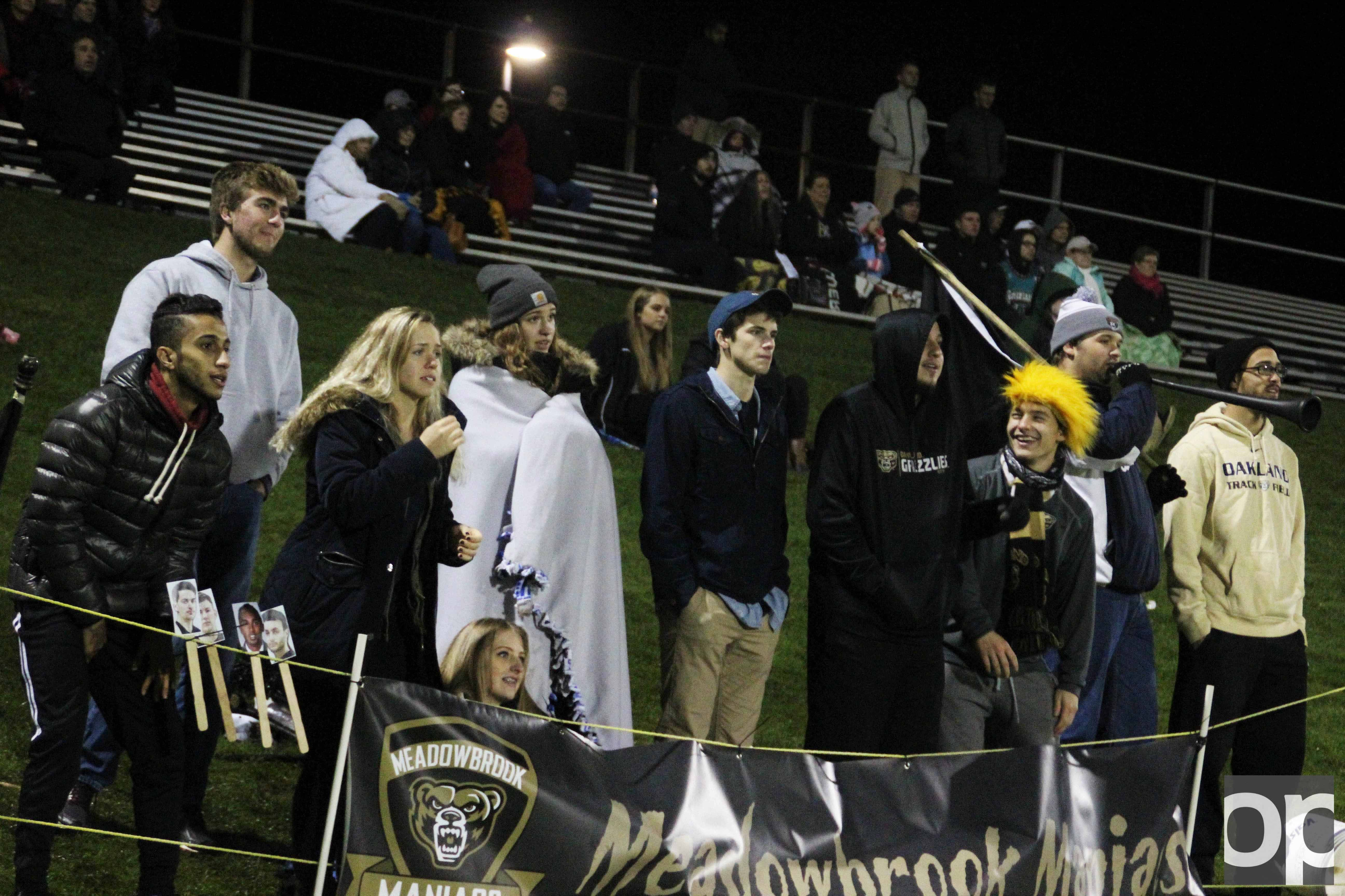 The Meadowbrook Maniacs support both the men's and women's soccer teams through chants during the games.
