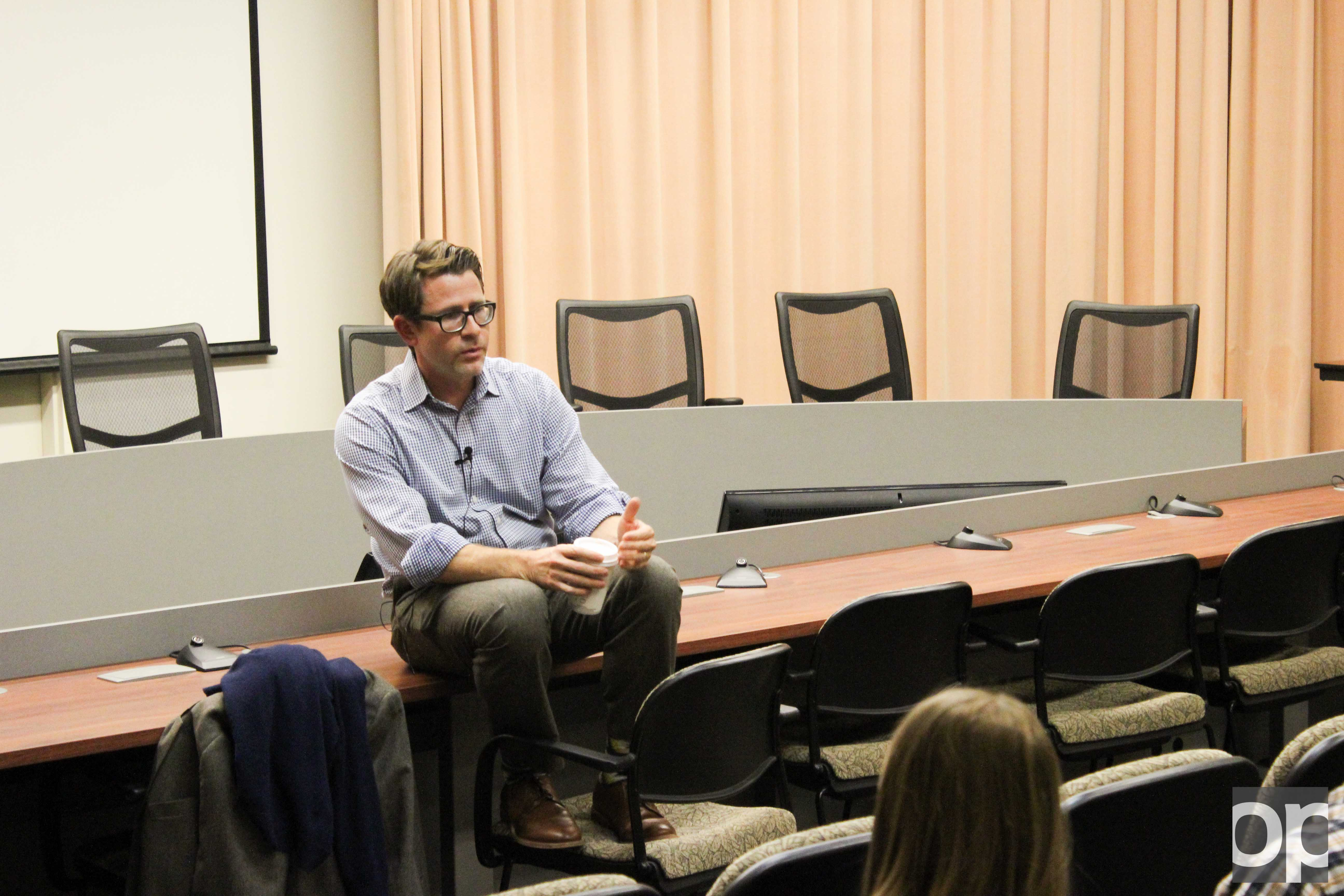 John Stoll of The Wall Street Journal speaks to a crowd on Wednesday, Oct. 26 at Elliott Hall.