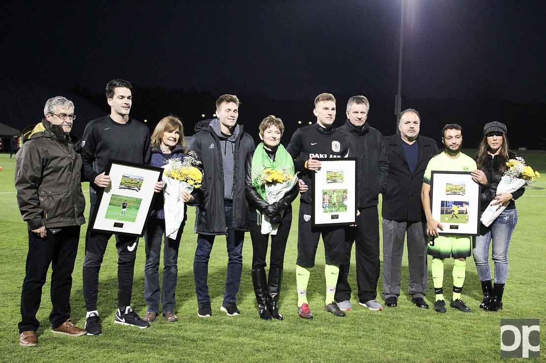 Seniors Brandon Woodfull, Alex Serwatka and Chase Jabbori get honored on senior night at the soccer field.