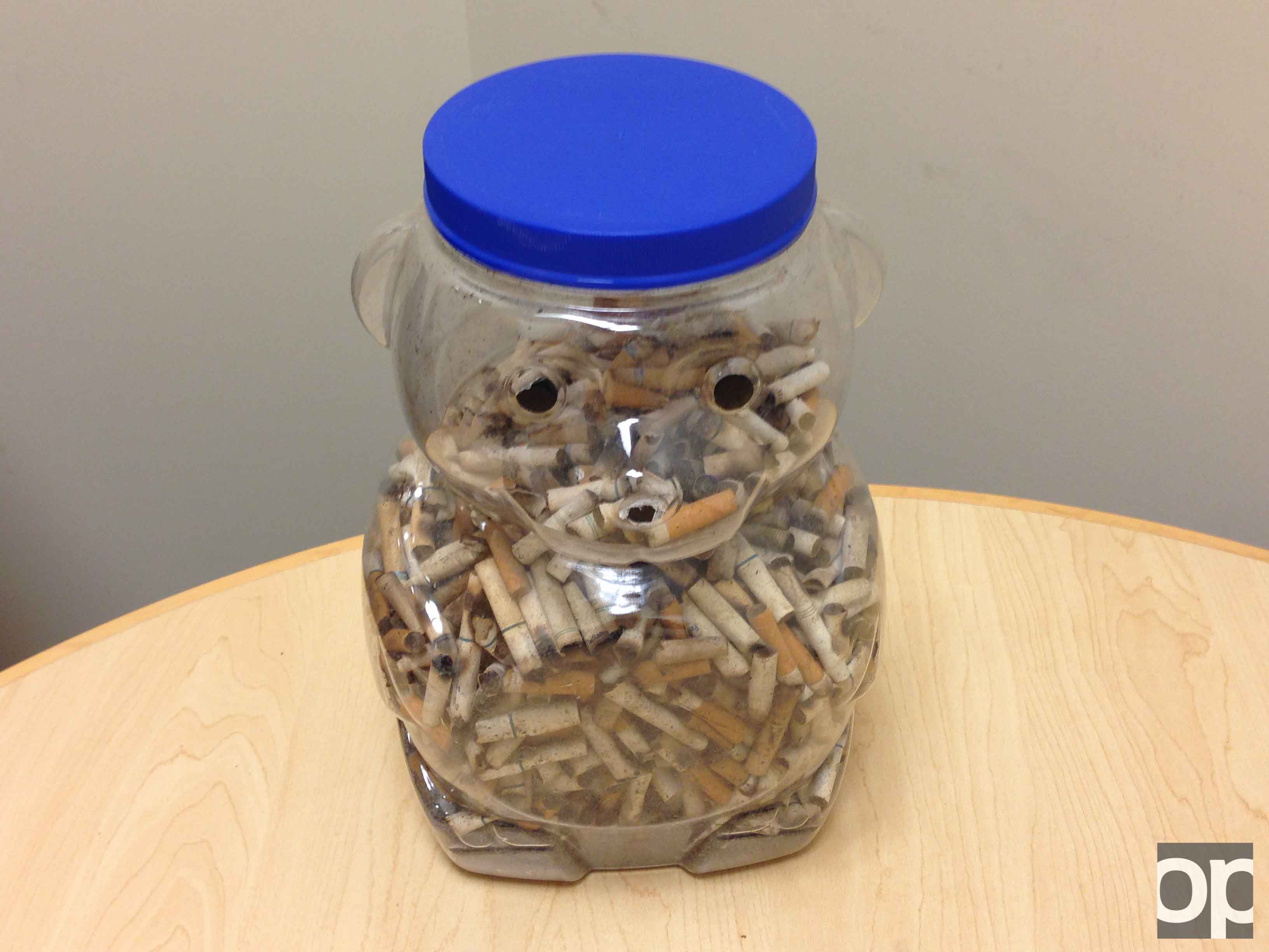 Health and Wellness Coordinator Erica Wallace collected used cigarettes around campus within an hour that almost filled up the bear jar on her desk.