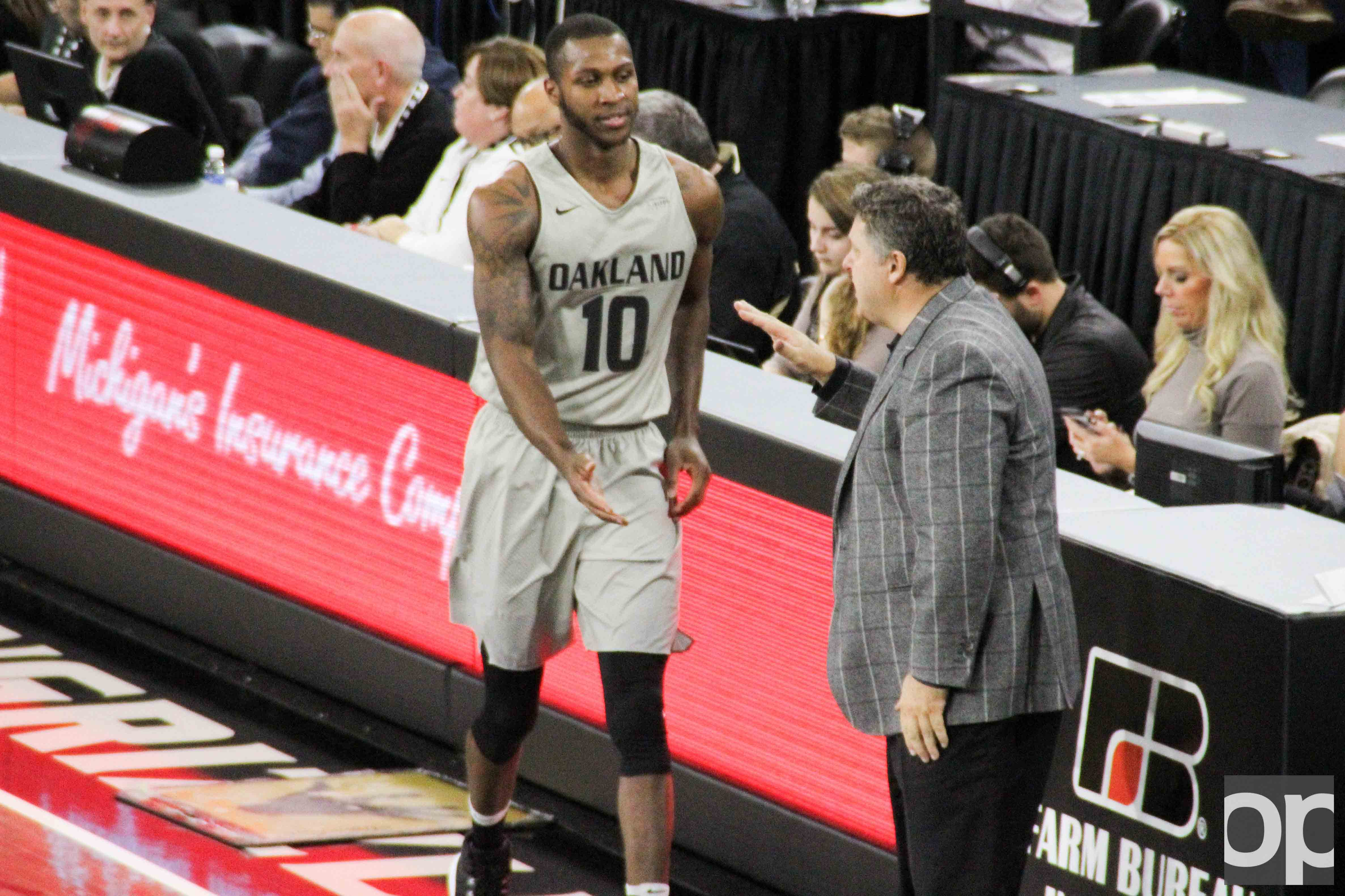 Isaiah Brock greets Head Coach Greg Kampe after checking out of the game against Chicago State on Saturday, Nov. 19, 2016.