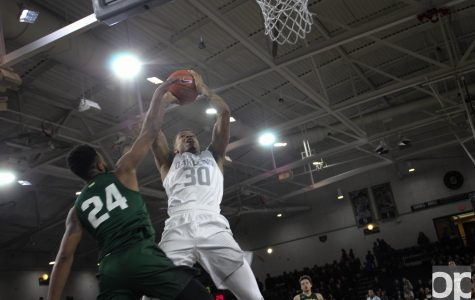 Men's basketball takes down Raiders in Horizon League opener