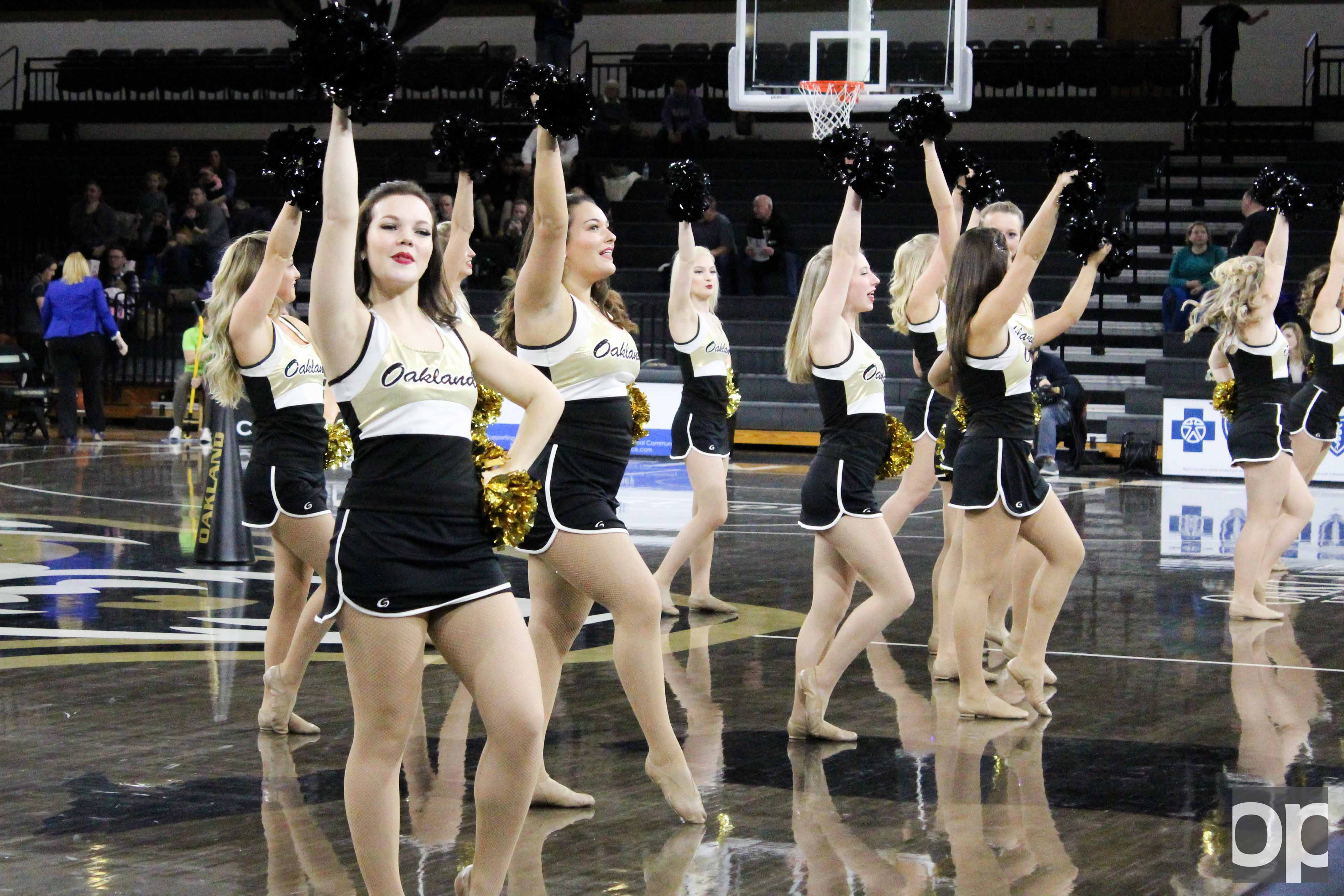 The Oakland dance team performs at halftime during a women's basketball game at the O'rena.