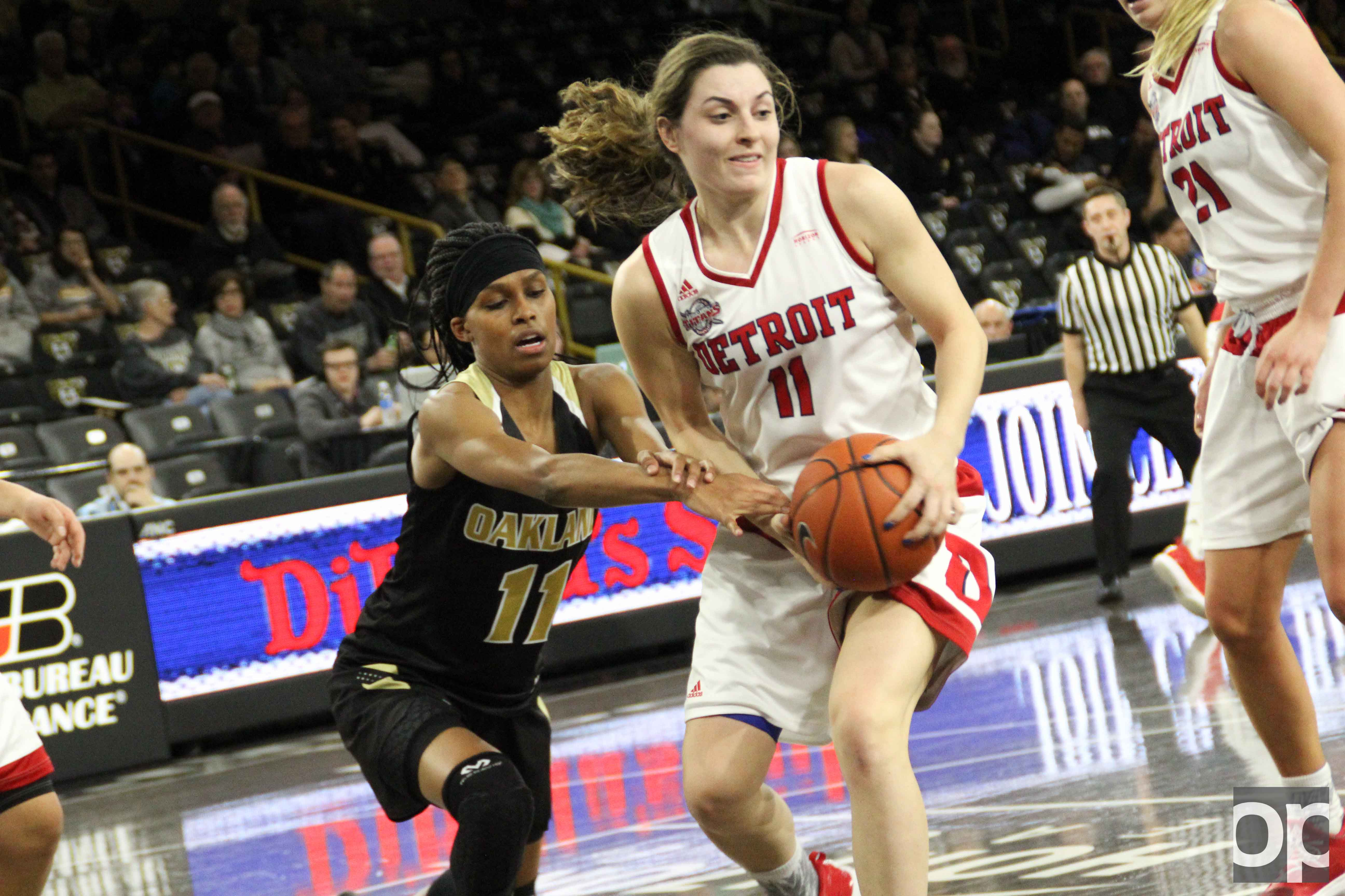 With 32 points from Rosanna Reynolds (#11), University of Detroit-Mercy beat Oakland 80-71 on Saturday, Jan. 7 at the O'rena.