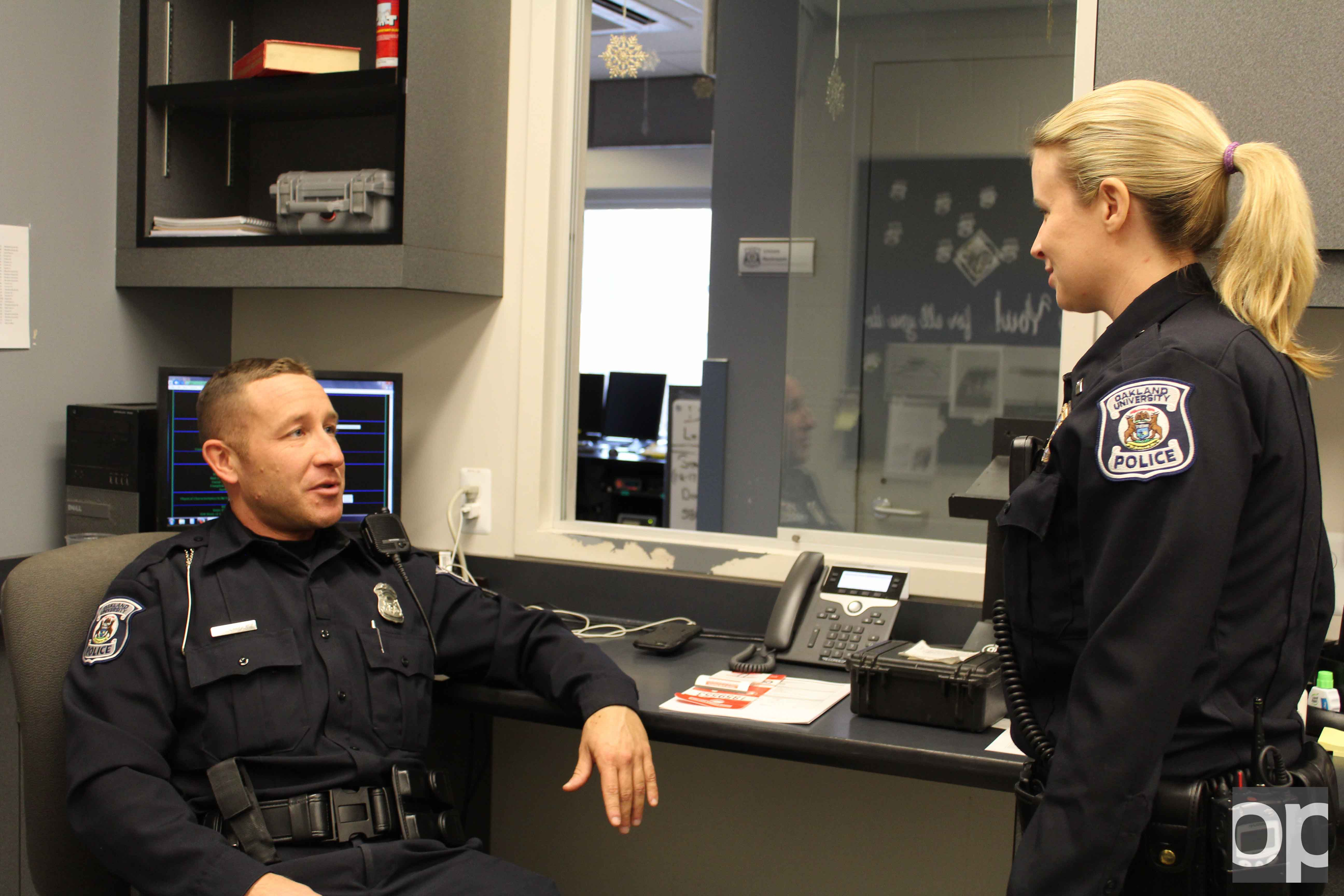 Officer Dwayne Rodriguez​ (left) and Lieutenant Nicole Thompson (right) chat inside the Police and Support Services building.
