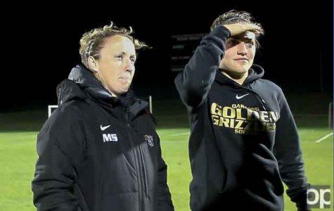 Margaret Saurin (left) served as Golden Grizzlies women's soccer head coach since March 6, 2014.