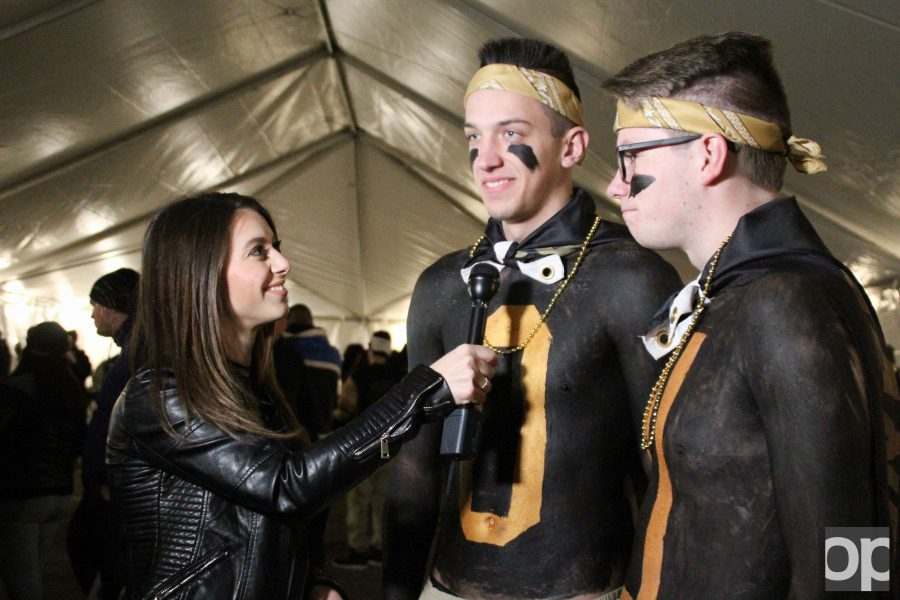 """Golden Grizzlies fans and freshmen Jacob Marczewski (center) and Michael Prestininzi (right) were interviewed at the tailgate. """"We both just wanted to do something special because of Winterfest, and it was a bigger game,"""" Marczewski said. """"We love going to the games and just wanted to express that. We figured the earlier we go, the bigger the impact we could have."""""""