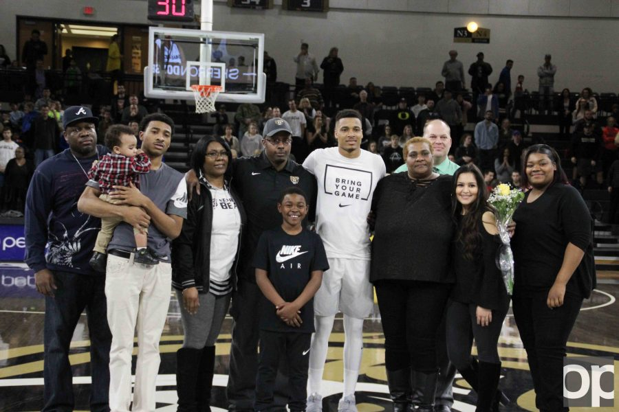 As part of the Senior Night celebration, Sherron Dorsey-Walker and his family were invited onto the Blacktop at the O'rena before the game.