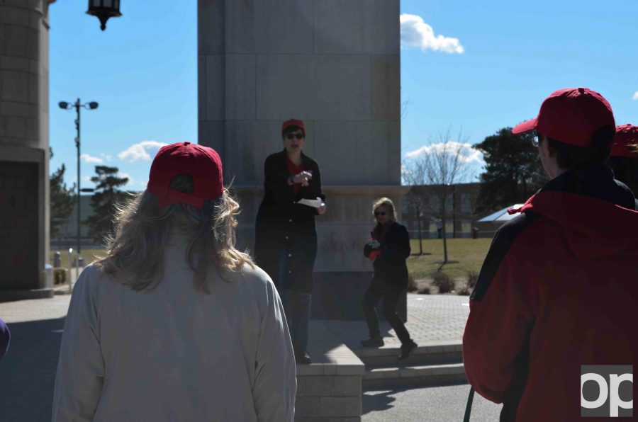 Students%2C+faculty+and+staff+come+together+wearing+red+%22Women+United%22+hats+in+support+of+the+Women%27s+Day+march.