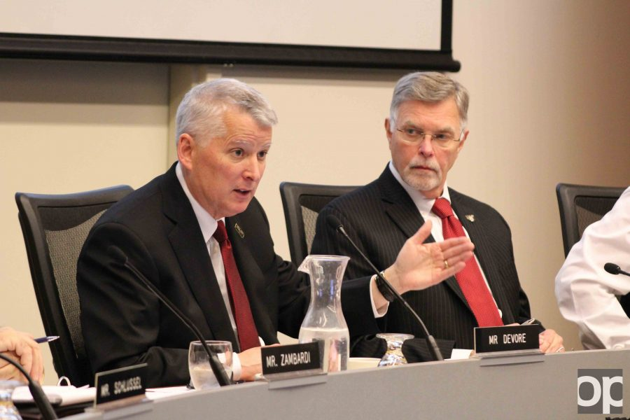 Oakland University President George Hynd (right) looks on as Board of Trustees Chair Richard DeVore gives a presidential search update at the April 3 board meeting.