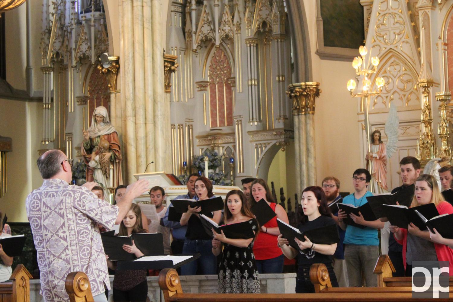 Oakland University Choral sings inside Sweetest Heart of Mary Roman Catholic Church before heading off to Europe.