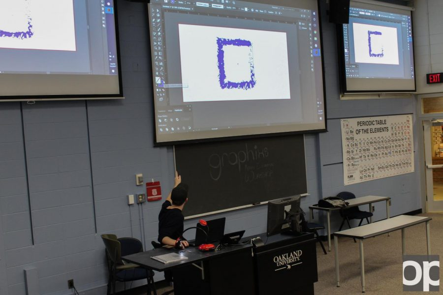 Graphix+helps+out+other+students+by+teaching+them+how+to+use+different+Adobe+programs+like+Illustrator+and+InDesign.
