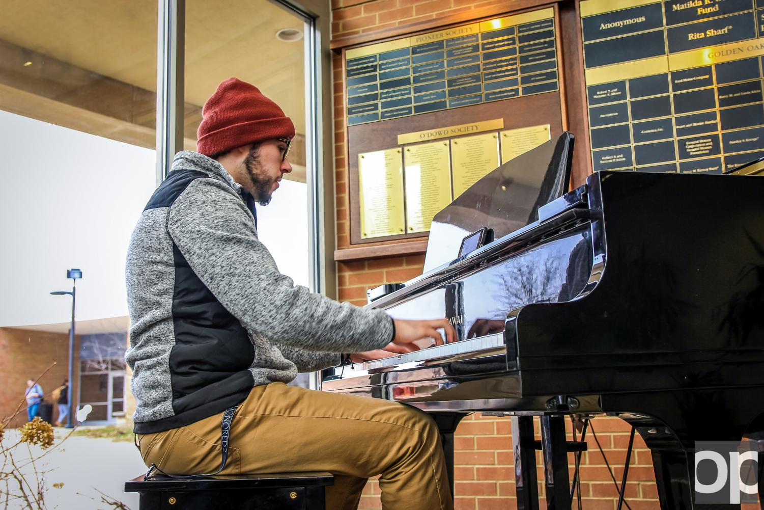 John Bollda comes to the OC to play on the grand piano for a few minutes