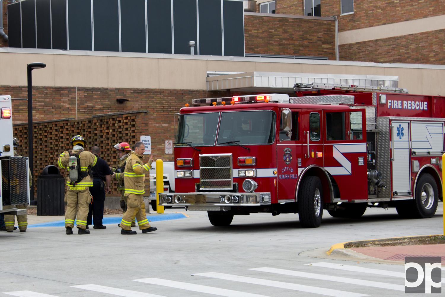 Firemen suit up to investigate the smoke in Vandenberg Hall.