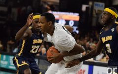 Men's basketball loses in home opener