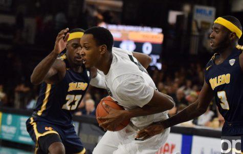 Men's basketball loses in home opener