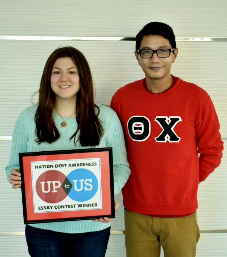 Essay winner Tia Falzarano with Oakland Up to Us Executive Director, Joseph Javier.