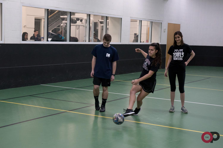 Joe DiFranco and April Peera warm up before a soccer game.